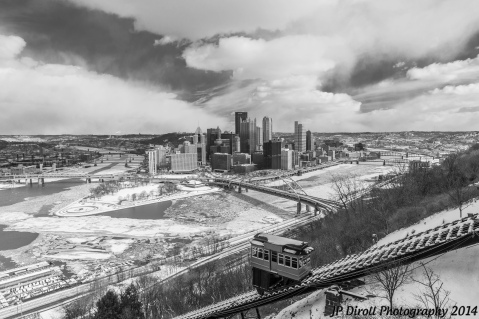 The Duquesne Inclines descends down Mount Washington towards the frozen rivers of Pittsburgh.