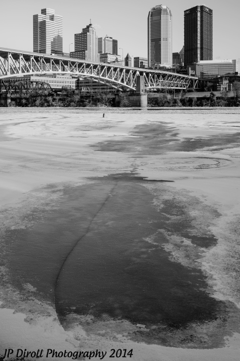 A crack in the ice leads you right to the Pittsburgh skyline.