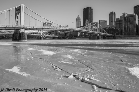 Very distinct cracks in the ice lead the way towards the 7th St. Bridge.