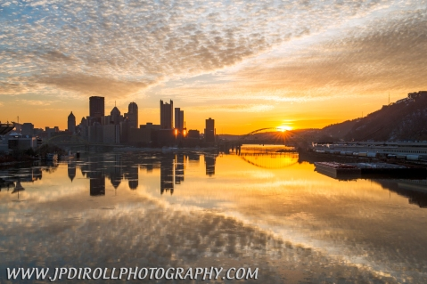 7:46 AM - Thirteen minutes later and the sun has crested the horizon, just over the Fort Pitt Bridge.  The light is now very warm and you will notice the skyline shows less detail in the buildings  due shooting directly towards the light.