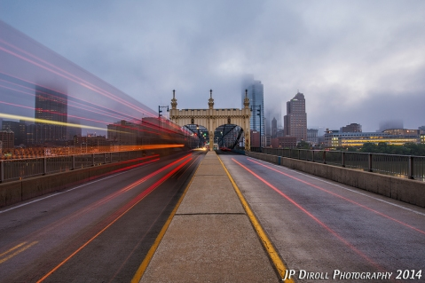 Buses flying past and long shutter speeds create an interesting dynamic to an already moody view from the Smithfield Street Bridge.