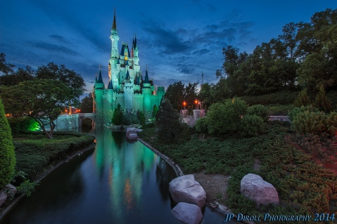 Cinderalla's Castle at Walt Disney World is a spectacle to see.  The reflections you can catch on either side (from the bridge to Tomorrowland or the bridge to Liberty Square) coupled with the lights at night paint (or photograph) one of the prettiest pictures you can imagine in the parks!