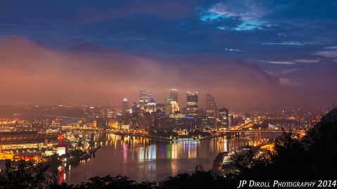 PHOTO 1 - This 13 second exposure retains much of the detail in the fog as it rolls into the city.