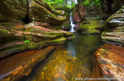 "3. ""Lines and Falls"" from Ricketts Glen State Park in northeastern PA is a beautiful little gem with graceful lines, colorful rocks and moss, and a serene waterfall."